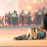 Make love not… riots – kissing couple in Vancouver