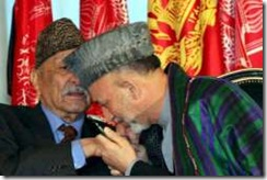 Afghan President Hamid Karzai (R) kissing the hands of the former Afghan King Zahir Shah after signing the country's new constitution in Kabul on 26 January 2004. Former Afghan King Mohammad Zahir Shah has died aged 92, on 23 July 2007. Shah ruled Afghanistan from 1933 until he was deposed in 1973 and lived in exile in Italy until returning back in 2002.