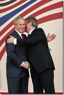 U.S. President George W. Bush is embraced by Albanian Prime Minister Sali Berisha during a press conference on Sunday, June 10, 2007 in Tirana, Albania.