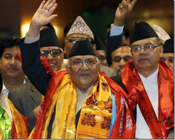 kp oli after sworning in as pm