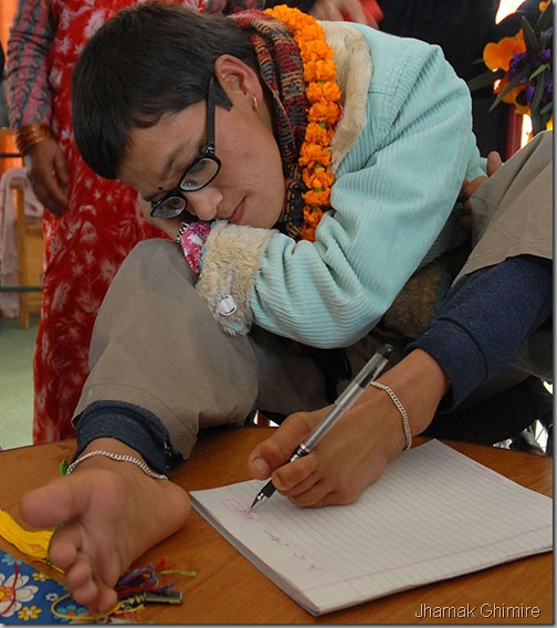 Jhamak_ghimire_writing_with_her_foot