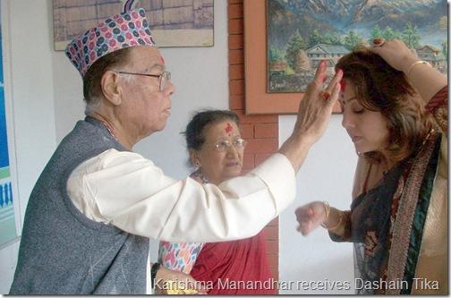 karishma_manandhar_taking_tika_from_ishwar_manandhar