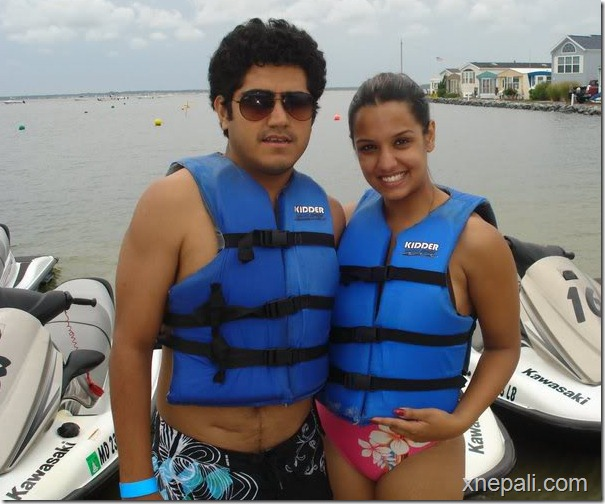 priyanka and rochak pose in the beach