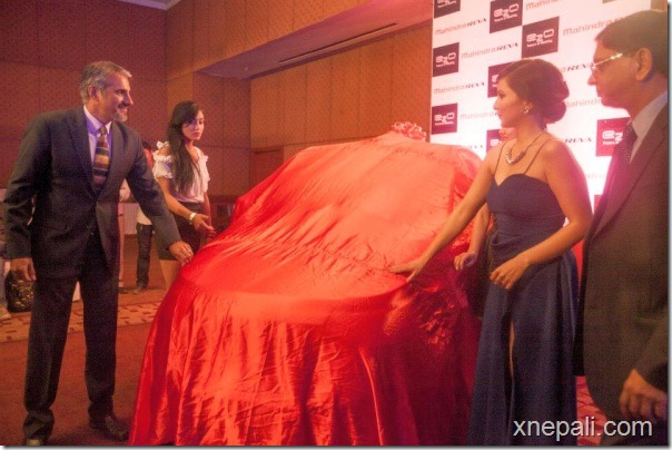 nisha adhikari removes the cover from E20 car