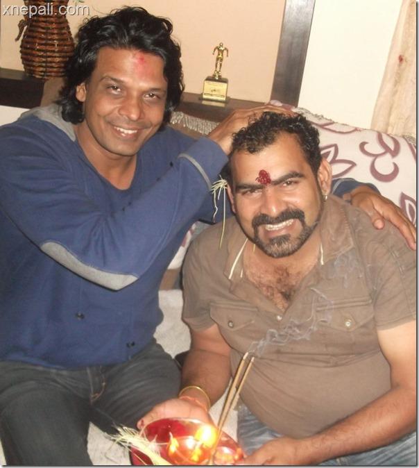 Puskar Bhatta receives tika from Biraj Bhatt (1)