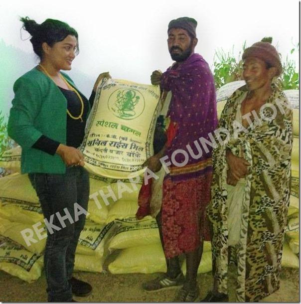 rekha distributes rice to Raute people