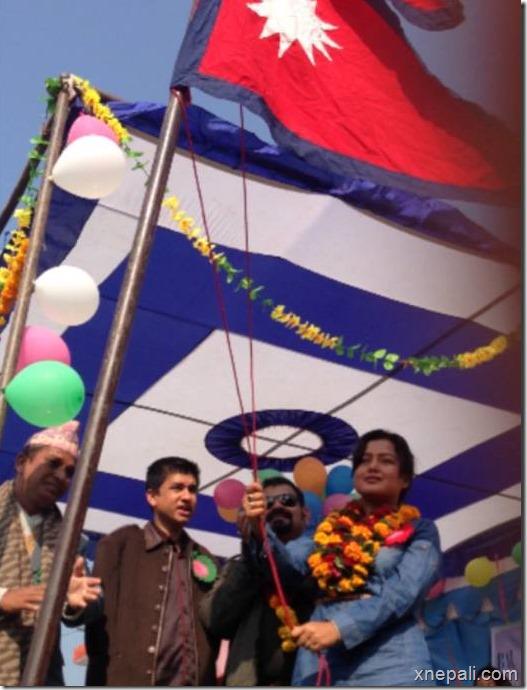 rekha thapa - lifting flag at mahendranager