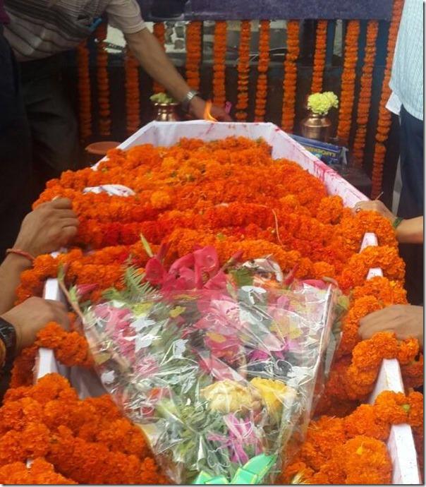 body of shree krishna shrestha covered in flower (1)