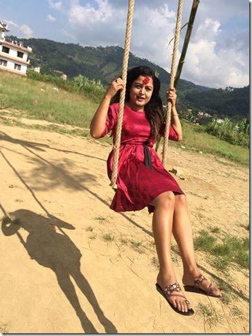 rekha thapa in a swing