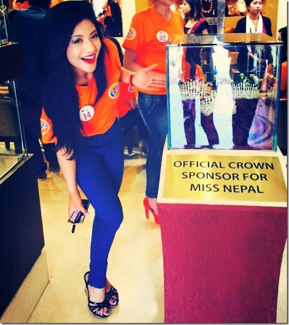 evana shows the crown of miss nepal