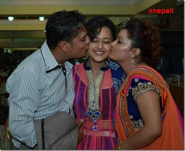 dilip rayamajhi with his wife and daughter
